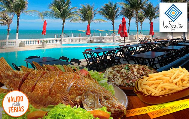 Férias com lazer e muitas delícias na Praia do Pacheco! Desconto em Tilápia Frita ou Peixada para 3 pessoas + Bônus: 2 pulseiras para acesso às piscinas, a partir de R$59,90 no La Suíte Praia Hotel.